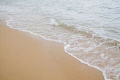 Soft wave of sea on the sand beach royalty free stock photography