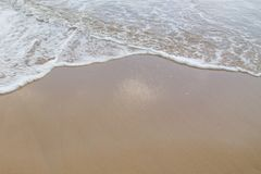 Soft wave of sea on the sand beach stock photography