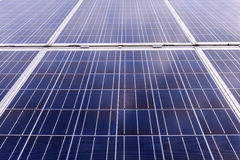 Close up of solar cells for renewable solar energy with the sun Royalty Free Stock Images