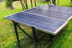 Solar panel in garden background stock photos