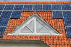 Close up on Solar panel on a red roof Stock Images