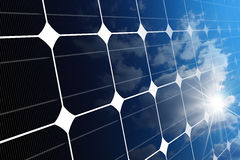 Close-up of a Solar Panel with Sun Rays Royalty Free Stock Photo