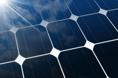 Close-up of a Solar Panel with Sun Rays. 3D illustration of a close-up of a Solar Panel photovoltaic panel with the reflection of a blue sky with clouds and sun Stock Image