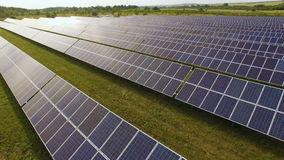 Close-up of solar panels on green grass with blue sky stock video footage