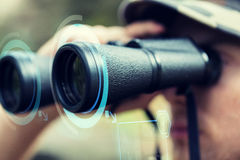 Close up of soldier or hunter with binocular Stock Image