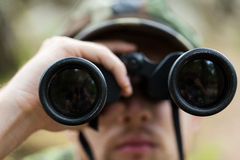 Close up of soldier or hunter with binocular Royalty Free Stock Photo
