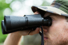 Close up of soldier or hunter with binocular Royalty Free Stock Photography