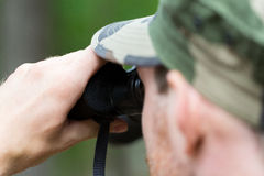 Close up of soldier or hunter with binocular Royalty Free Stock Images