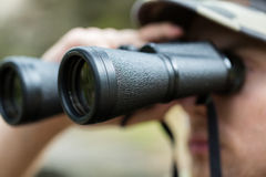 Close up of soldier or hunter with binocular Stock Photography