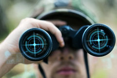 Close up of soldier or hunter with binocular Stock Images