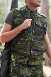 Close up of soldier or hunter with gun in forest Royalty Free Stock Image