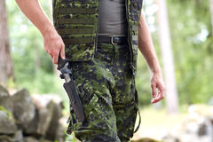Close up of soldier or hunter with knife in forest Royalty Free Stock Photos