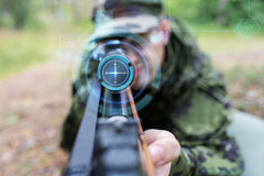 Close up of soldier or sniper with gun in forest Stock Photos