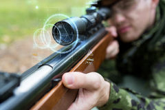 Close up of soldier or sniper with gun in forest Royalty Free Stock Photos