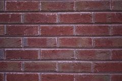 A close-up of a solid red brick wall Stock Photo
