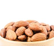 Close up some almonds in bowl. On white background Royalty Free Stock Images