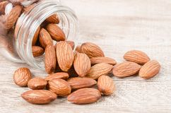 Close up some almonds. Close up some almonds on wooden background Stock Photos