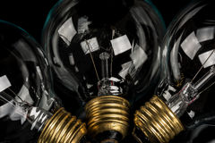 Close up of some classic incandescent light bulbs. Clear glass light bulbs close up Stock Images