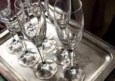 close up of some empty glass wine cups on a silver tray very clean ready to be used at a restaurant in a party royalty free stock photography