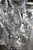 close up of some empty glass wine cups on a silver tray very clean ready to be used at a restaurant in a party stock photography
