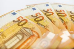 Pile of 50 euro notes - business background. Close up of some 50 euros bills Stock Image