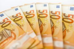 Close up of some 50 euros bills. Pile of 50 euro notes - business background Royalty Free Stock Image