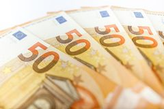 Close up of some 50 euros bills. Pile of 50 euro notes - business background Royalty Free Stock Photography