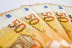 Pile of 50 euro notes - business background. Close up of some 50 euros bills Royalty Free Stock Photos