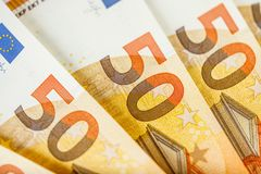 Close up of some 50 euros bills. Pile of 50 euro notes - business background Royalty Free Stock Images