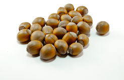 Close-up of some hazelnuts. On a white background royalty free stock photo