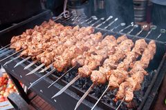 Close up of some meat skewers, grilled in a barbecue stock images