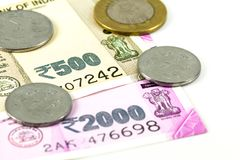 Close-up of some new indian rupee bank notes with coins. With copy space royalty free stock photography