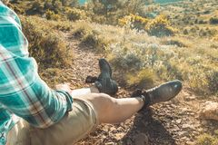 Close-up of old leather boots .Close-up of legs in the mountains. Close-up of some old leather boots. Man with old boots in the mountains royalty free stock photos