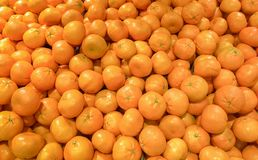 Close up of some oranges fruit. A pile of tangerines stock photography