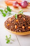 Bowl Of Lentils With Carrots. Close up of some organic brown lentils Royalty Free Stock Photography