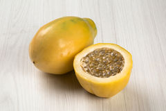 Close up of some passion fruits over a white background. Royalty Free Stock Images
