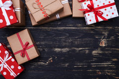 Close-up of some present boxes placed on the wooden background. High angle of some present boxes placed on the wooden background. Place for copy space isolated royalty free stock photography