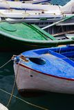 A close up of some small wooden colorful fishing boats at the po. Rt of Aegiali Royalty Free Stock Images