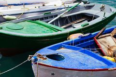 A close up of some small wooden colorful fishing boats at the po. Rt of Aegiali royalty free stock photography