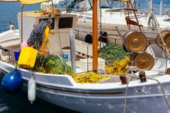 A close up of some small wooden colorful fishing boats at the po. Rt of Aegiali Royalty Free Stock Image