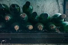 Close up of some very old and dusty wine bottles in a wine cellar stock image