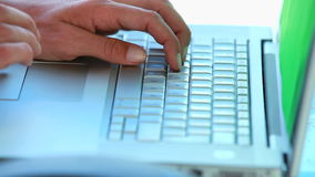 Close up on someoness hands typing on a laptop stock footage