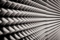 Close up Sound Absorption, noise reduction texture in recorder room ,with light flare.  royalty free stock photography