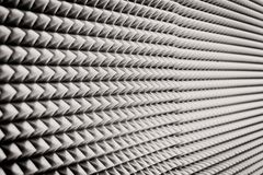 Close up Sound Absorption, noise reduction texture in recorder room ,with light flare.  royalty free stock image