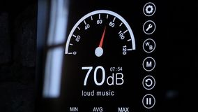 Close-up of sound level meter screen in decibels. Modern electronic sound meter around royalty free stock photography
