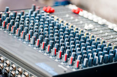Close-up of sound mixer control panel with many controls Stock Photos