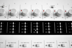 Close up of a sound mixer knobs. Close up of a digital sound mixer knobs and recording level Stock Photo