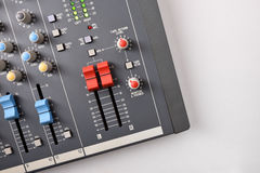 Close up sound mixer top view on white table Royalty Free Stock Images