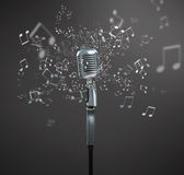 Close up of sounding silver microphone. On grey. Concept of music and arts royalty free stock photo