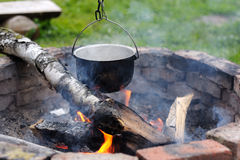 Close up of soup cooking over campfire. Travel. Royalty Free Stock Photo